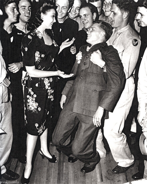 """A solider goes """"weak at the knees"""" after Linda Darnell asks him to dance at the Hollywood Canteen, 1940."""