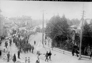 1919.Организованные после оккупации Архангельска отряды русских добровольцев прошлись маршем по улицам города