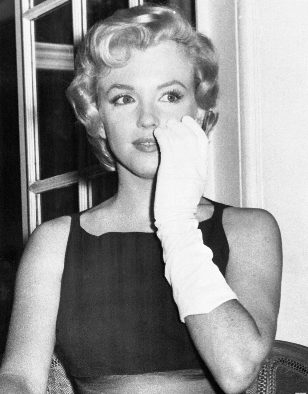 Marilyn Monroe Holding Gloved Hand to Face