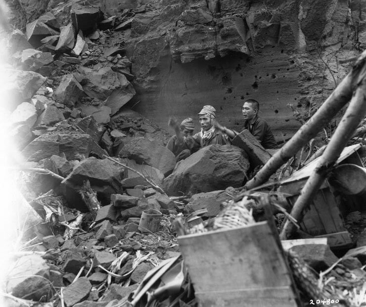 Three Japanese soldiers emerged from their hiding place to surrender, Iwo Jima, 5 Apr 1945