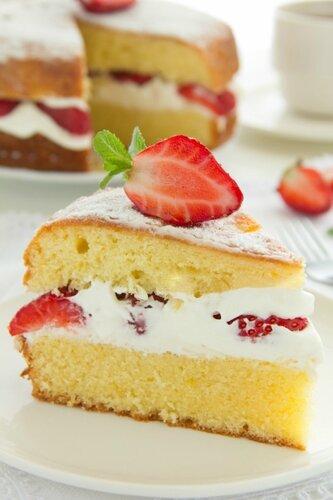 Victorian sponge cake with cream and strawberries.