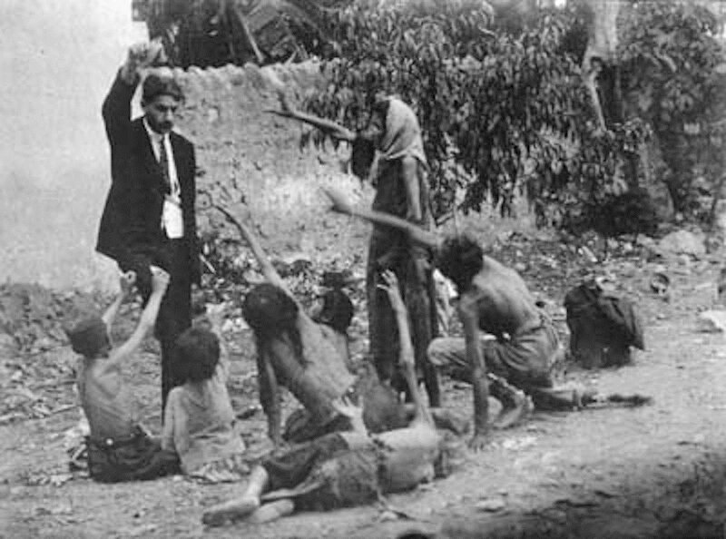 Turk_official_teasing_Armenian_starved_children_by_showing_bread,_1915_(Collection_of_St._Lazar_Mkhitarian_Congregation)