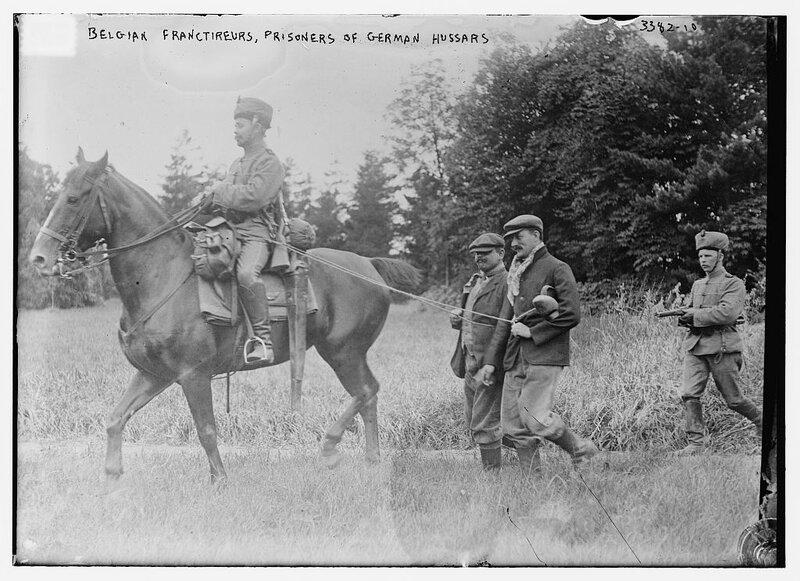 Belgian Francs-tireurs taken prisoner by German hussars, c. 1914