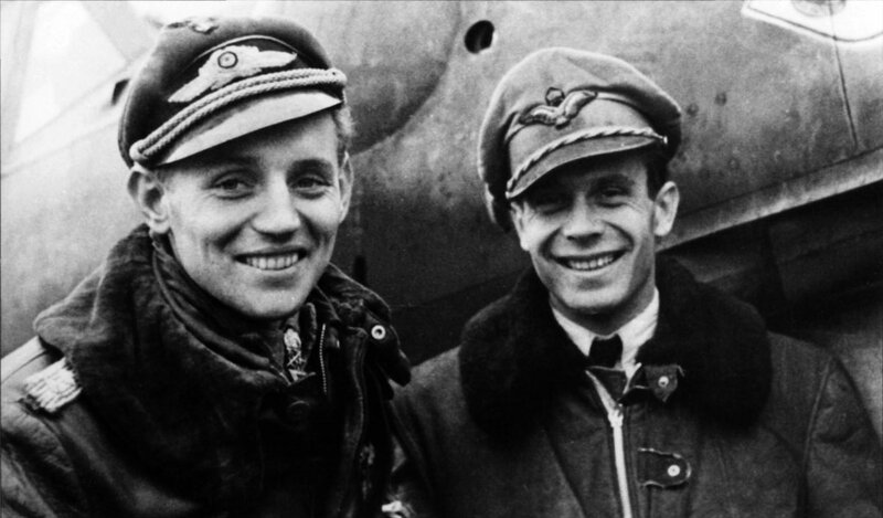 Top WWII ace, with 352 aerial victories, Erich Hartmann, left, poses with Hungarian pilot Laszlo Potyondi, right. (November, 1944)