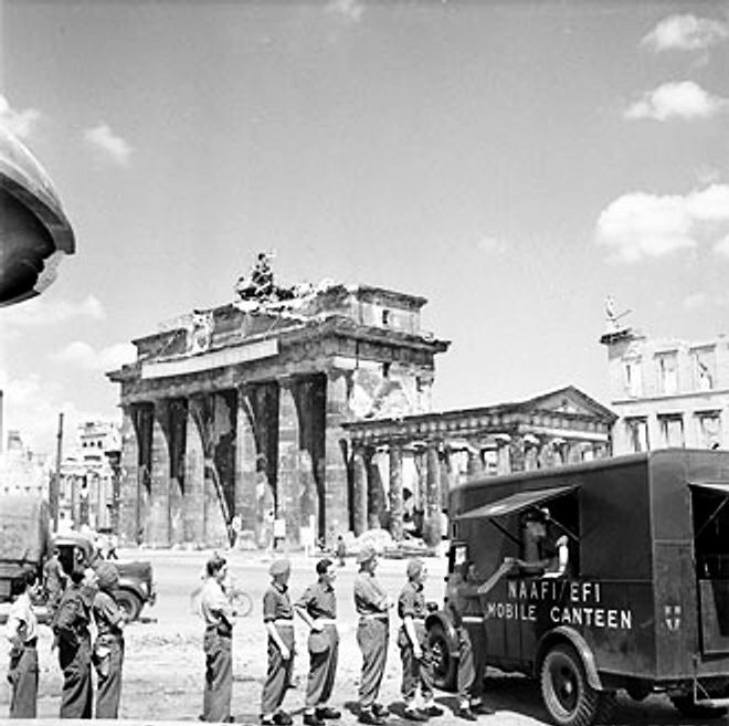British soldiers in line for tea at NAFFI Mobile Canteen No. 750 at the Brandenburg Gate in Berlin