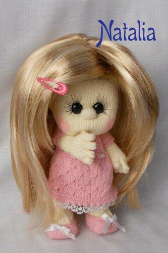 Маленькую куклу связала по