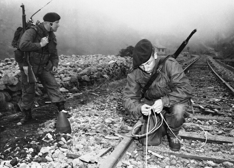 British Royal Marines Commandos, put ashore by a U.S. naval vessel deep in the heart of North Korea, plant demolition charges along an enemy rail track on April 13, 1951 near Songjin, South Korea during a daring dayligh