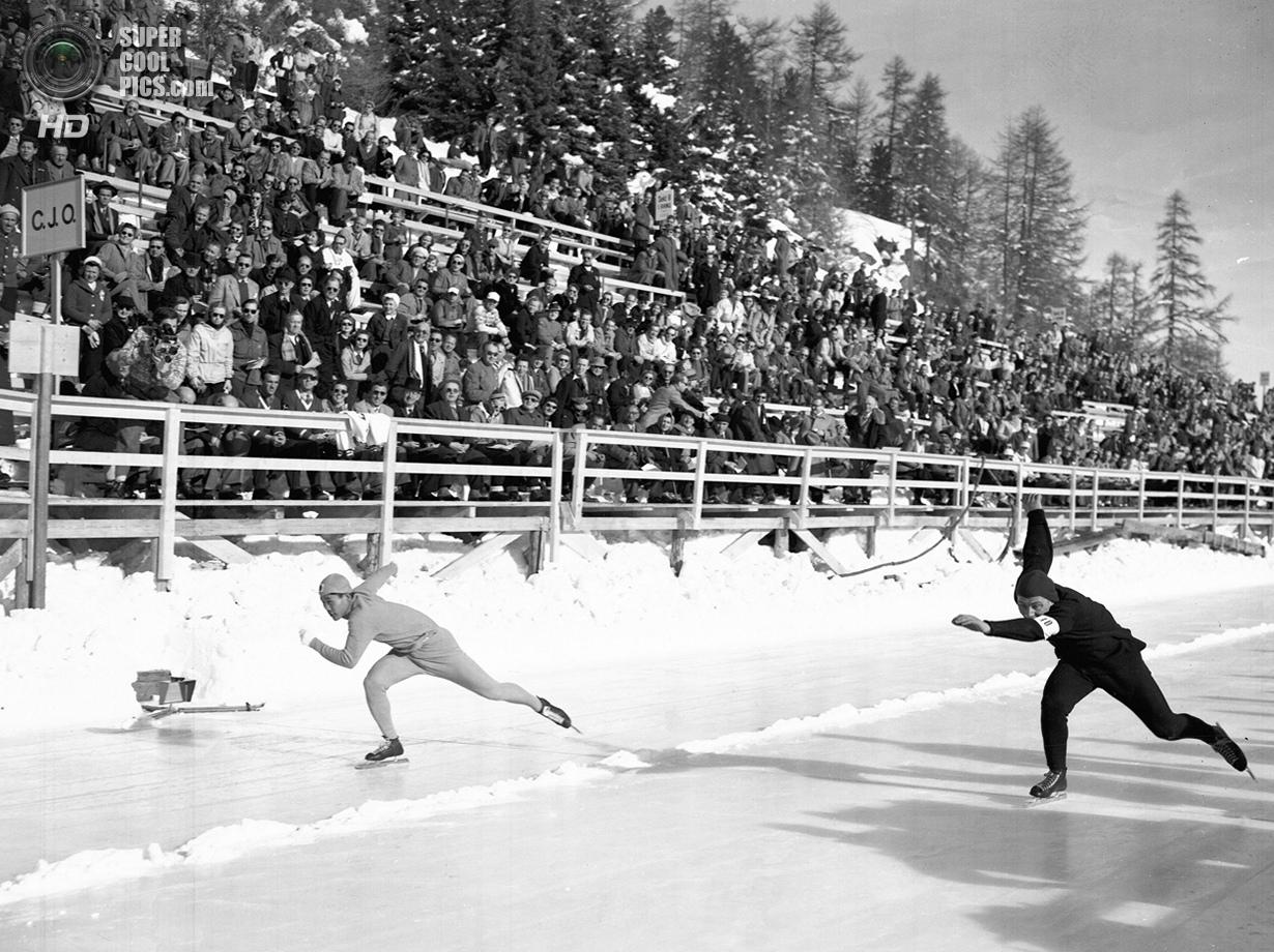 Швейцария. Санкт-Мориц, Граубюнден. 31 января 1948 года. Хиджо Чхан Ли из Кореи и Антон Хёйскес из Н