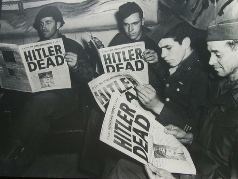 Servicemen read of Hitler's death