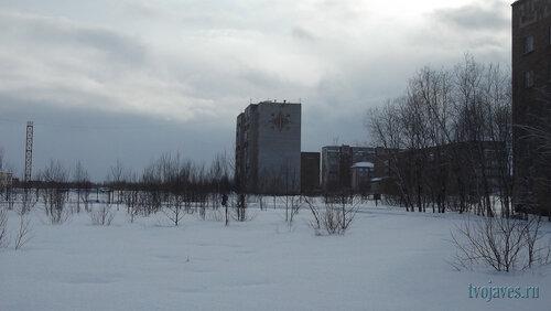 Фото города Инта №6495  Северо-восточный угол Куратова 60 (та же точка съёмки, вид правее) 12.03.2014_12:41
