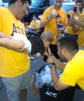 Baby-doing-a-keg-stand-at-ASU-tailgate.jpg