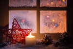 Frosted window with festive candles