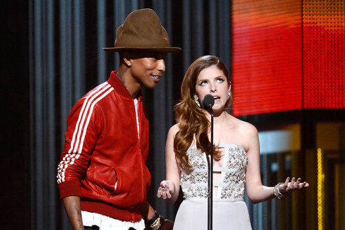 LOS ANGELES, CA - JANUARY 26: Musician Pharrell Williams (L) and actress Anna Kendrick speak onstage during the 56th GRAMMY Awards at Staples Center on January 26, 2014 in Los Angeles, California. (Photo by Kevork Djansezian/Getty Images)