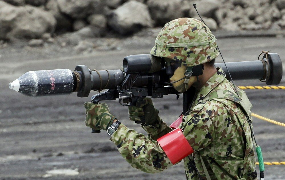 A Japanese Ground Self-Defense Force holds an anti-tank weapon during an annual training exercise at Higashifuji training field near Mount Fuji in Gotemba