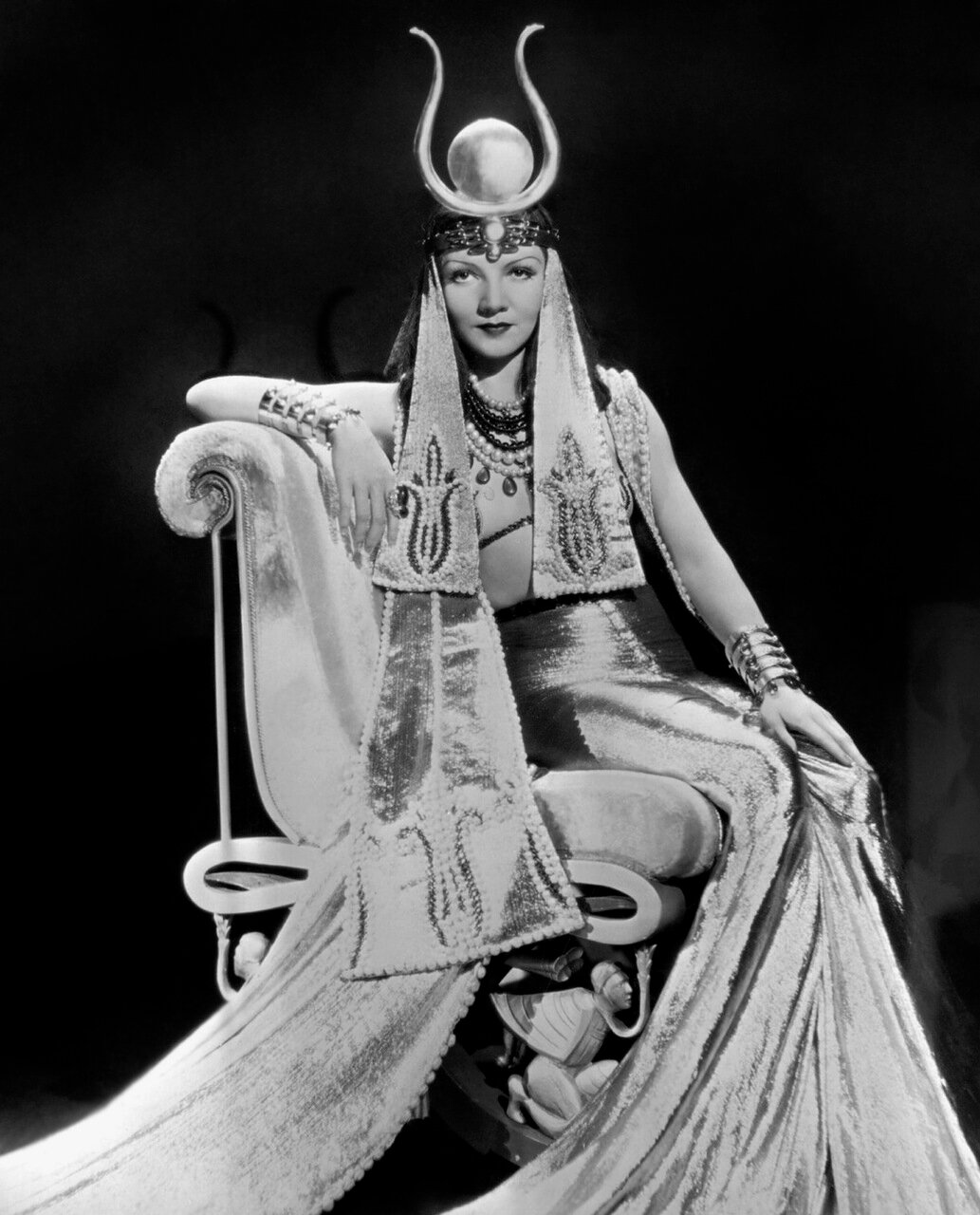 1934: Claudette Colbert (Lily Chauchoin, 1903 - 1996), as she appears in the title role of Cecil B DeMille's 'Cleopatra'. Costume designed by Travis Banton.
