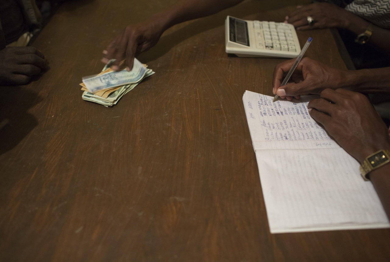 Members of the Berahile Salt Association pay a merchant after purchasing salt in the town of Berahile in Afar, northern Ethiopia