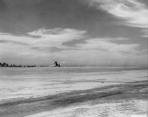 """This 72nd Fighter Squadron North American P-51 """"Is This Trip Necessary"""" was almost junk after it crashed on the runway at Iwo Jima, Bonin Islands.   The left landing gear collapsed as the plane landed; it was returning from an escort mission over Tokyo, J"""