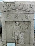 Стела надгробная с рельефным изображением воина. Известняк.