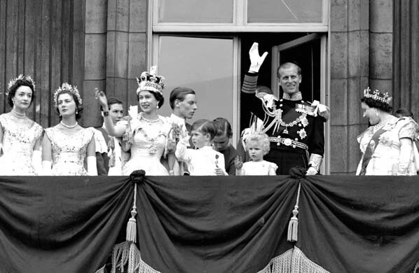 ** FILE ** Britain's Queen Elizabeth II waves from the balcony of Buckingham Palace, following her Coronation at Westminster Abbey, in this June 2, 1953 file photo. Also seen are Prince Charles, centre, Princess Anne, third right, Prince Philip, second ri