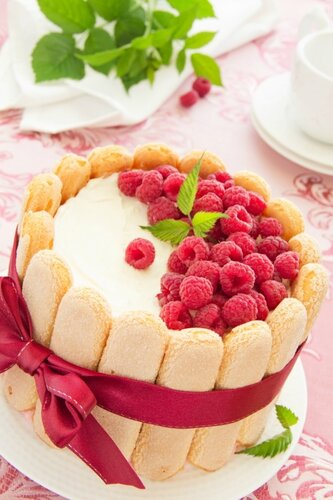"""Cake """"Charlotte"""" with raspberries and cream, selective focus."""