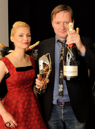 LONDON, ENGLAND - DECEMBER 08: Presenter MyAnna Buring (L) and director David Mackenzie, accepting on behalf of Best Supporting Actor winner Ben Mendelsohn, pose backstage at the Moet British Independent Film Awards 2013 at Old Billingsgate Market on Dec