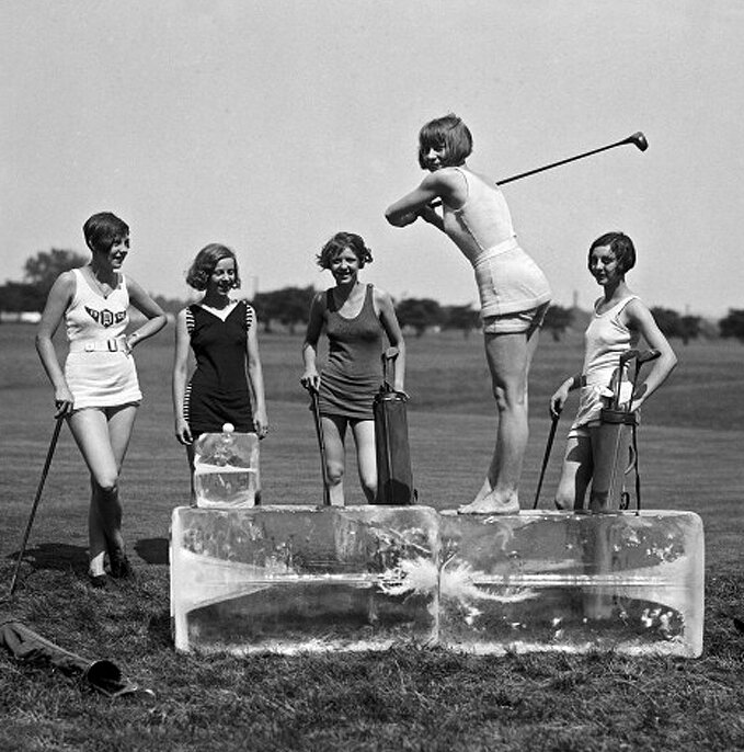 A young woman in a bathing suit tees off from a cake of ice on a hot day in Washington while four others await their turn, Washington DC, July 9, 1926.