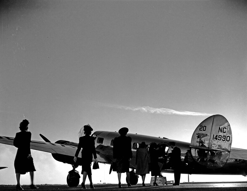 A group of models boarding a Lockheed Model 10B Electra, owned by Delta Air Lines, at Dallas Love Field Airport. March 1940