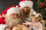 Santa Claus sitting at home with family