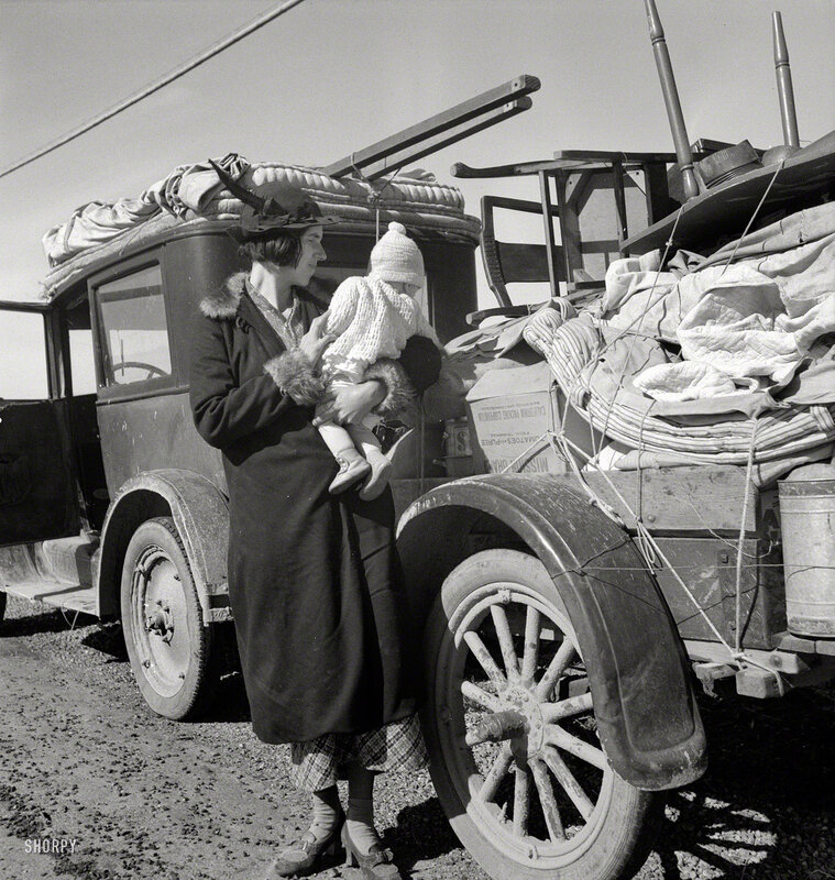 February 1937. Tracy (vicinity), California. U.S. Highway 99. Missouri family of five, seven months from the drought area. Broke, baby sick, car trouble