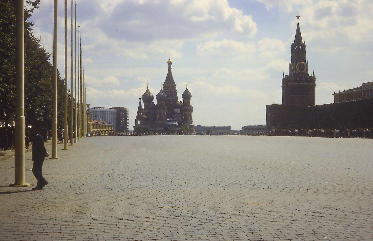 Red Square-St. Basil's Cathedral at far end. Kremlin with Spasskaya Tower (Savior Tower).Tower built 1491.