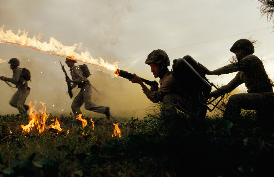 Marine infantry in Taiwan practice using flame throwers in a simulated battle, January 1969.Photograph by Frank and Helen Schreider, National Geographic