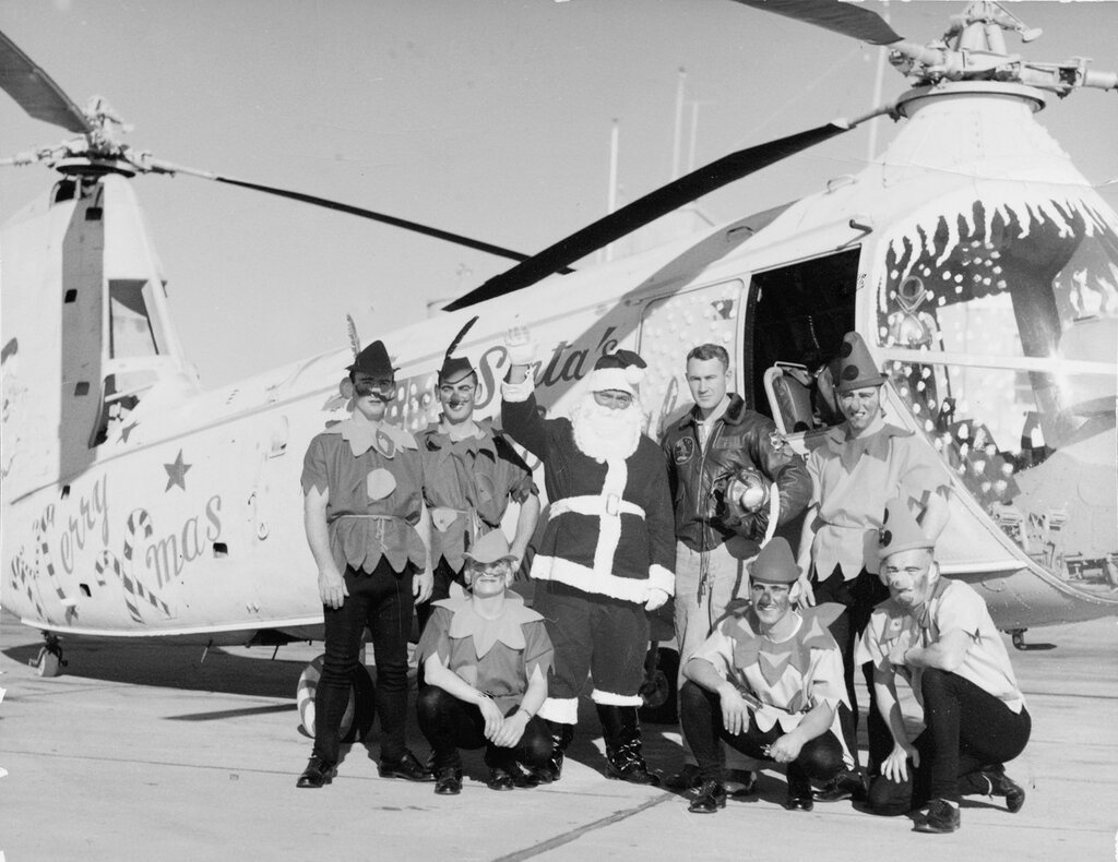 Santa and elves arrive by special helicopter for a children's Christmas party at Naval Air Station Oakland, 23 December 1956.