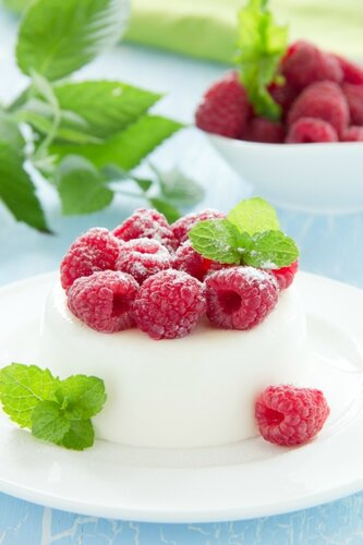 Vanilla panna cotta with raspberries.