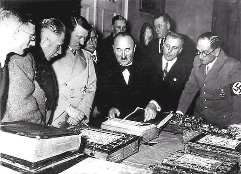 Top German officials visiting the Bavarian State Library, 7 Jan 1936; L to R: Karl Fiehler, Franz von Papen, Adolf Hitler, Ludwig Siebert, Georg Leidinger, Rudolf Buttmann, Franz von Epp