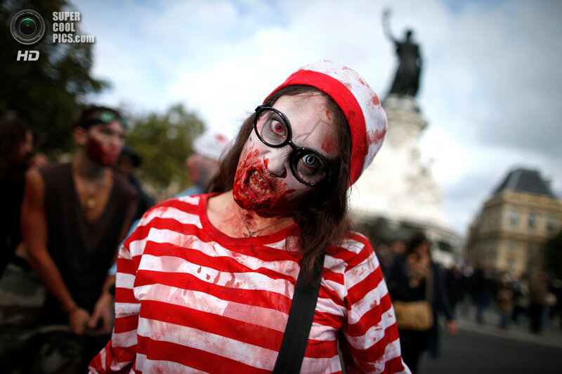 A woman dressed as a zombie participates in a Zombie Walk procession in the streets of Paris