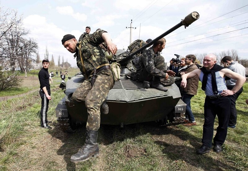 A Ukrainian soldier jumps off an armoured personnel carrier in Kramatorsk