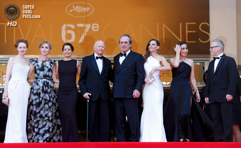 """Director and actor Tommy Lee Jones and cast members pose on the red carpet as they arrive for the screening of the film """"The Homesman"""" in competition at the 67th Cannes Film Festival in Cannes"""