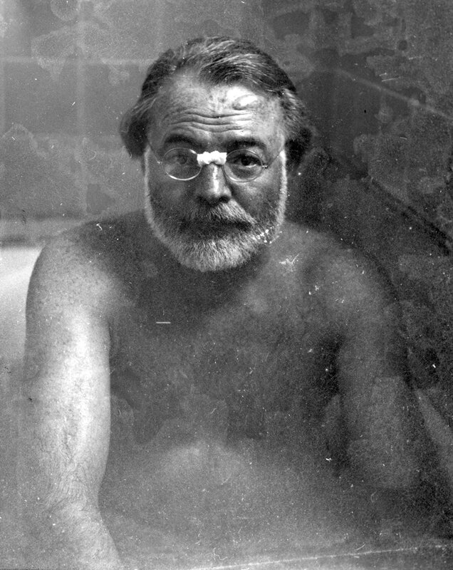 Ernest Hemingway bathes aboard the S. S. Jagiello en route from Genoa to Cuba, April/May 1949.