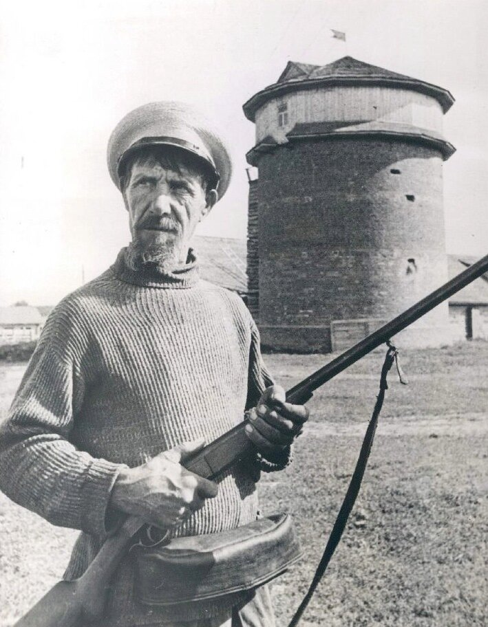 A Russian collective farmer stands guard near a stable after the German declaration of war against the Soviet Union, 1941