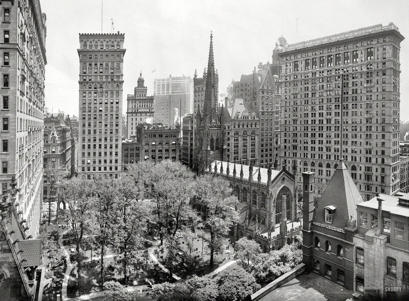 New York circa 1908. Trinity churchyard and skyscrapers
