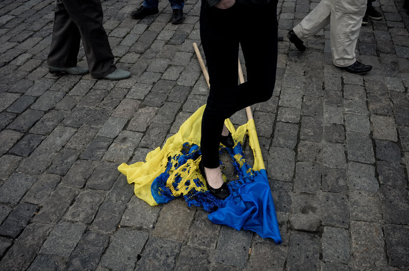 Pro-Russian activists burn the Ukrainian flag in front ofthe Regional Administration in Kharkiv, where police has strengthened the protection expecting that participants of May Day demonstration can try to seize the building.