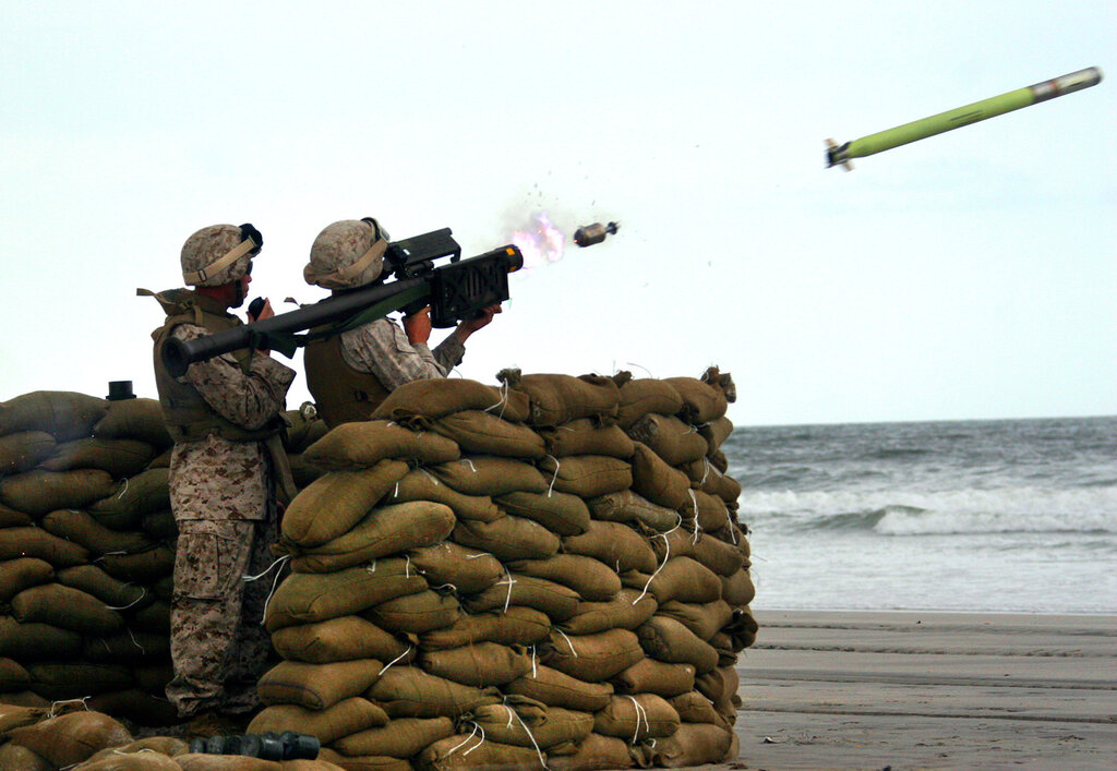 Staff Sgt. Tony L. Moore, Alpha Battery section leader with 2nd Low Altitude Air Defense Battalion, coaches a 2nd LAAD Marine as they fire off a Stinger missile Sept. 13 at Onslow Beach on Marine Corps Base Camp Lejeune.Photo by: Cpl. Adam F. Testag
