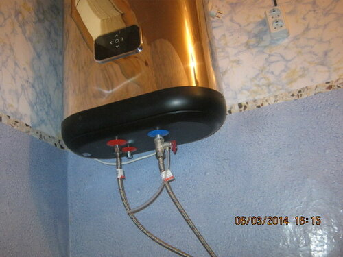 Установили водонагреватель, провели к нему электричество, подключили воду и запустили в работу. Аминь!