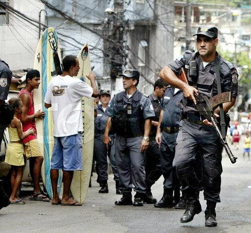 Policemen on patrol inside a shantytown in Rio de janeiro