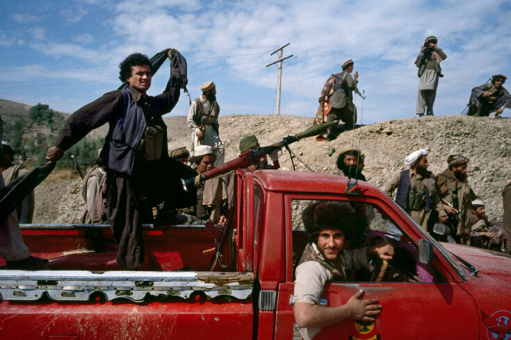 02.1_117C: Afghan mujahideen fighters move toward the frontline during the battle for Jalalabad March, 1989.