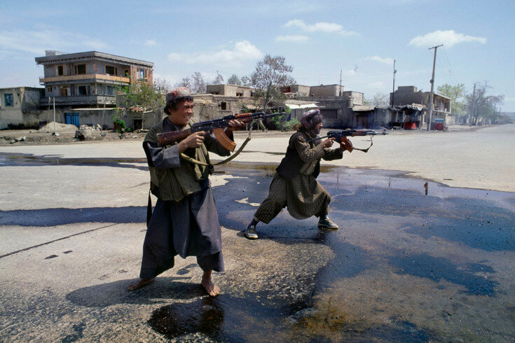 06.1_137: April, 1992 Two Uzbek fighters under the control of Afghan General Abdul Rashid Dostum fire on Hezbi-Islami forces of Gulbuddin Hekmatyar in the SW part of Kabul during the mujahideen takeover of Kabul. Once a truce had been declared on April 30