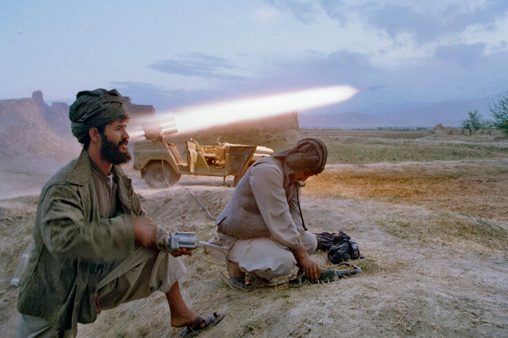 Sec3_10_154: September, 1996 Taliban soldiers fire a rocket at retreating forces of Ahmed Shah Massoud September 26, 1996, north of Kabul. The Afghan government headed by President Burhanuddin Rabbani fled the capital once Taliban forces broke through fro