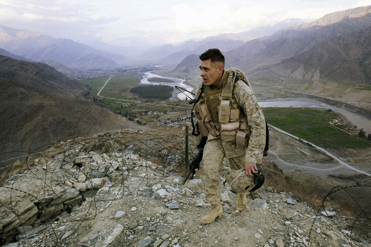 ASADABAD, AFGHANISTAN - JANUARY 31: A U.S. Marine, Corporal Gravenese from Harrison, New York, patrols in Asadabad, Afghanistan, 10 kms from the Pakistani border, January 31, 2004. Asadabad, in Kunar Province, is part of the ethnic Pathan tribal belt in e