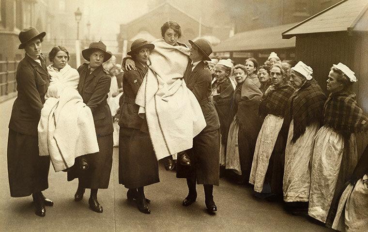 Workhouse women watch WWI female war workers practice firefighting