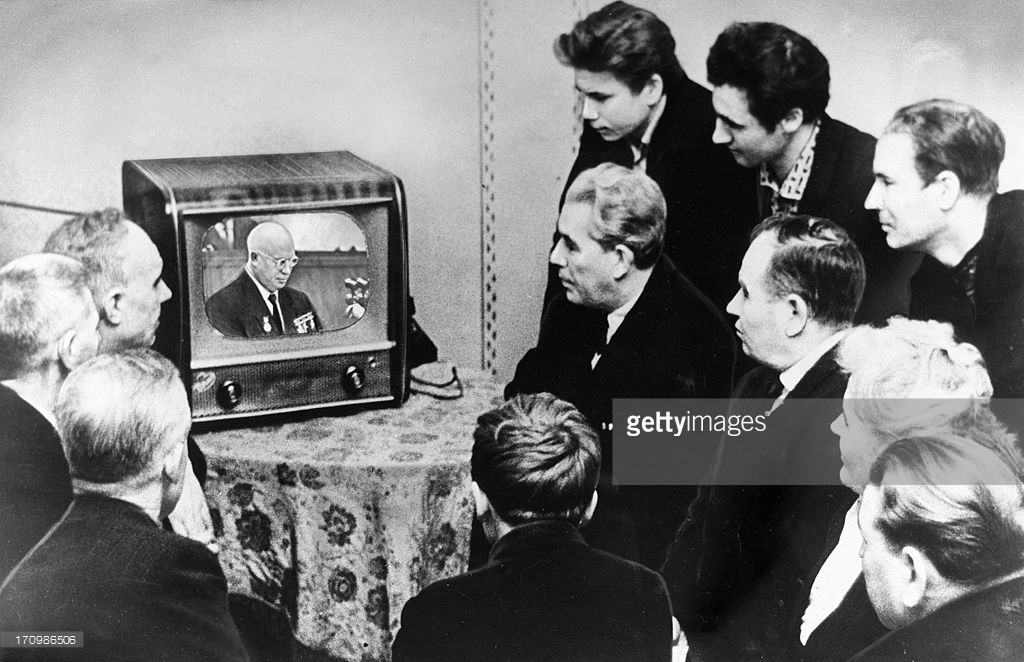 Workers of the state bearing plant no, 1 in moscow, watching nikita khrushchev give a report at the ussr supreme soviet on the present day international situation and the foreign policy.jpg